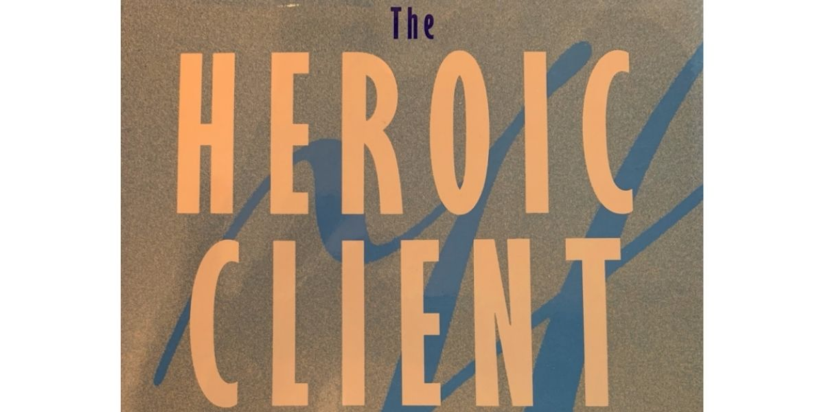 "The cover of a book titled ""The Heroic Client"""