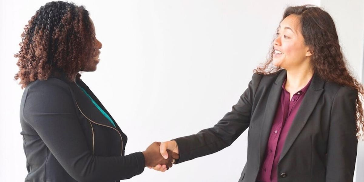 Two effective therapists shaking hands
